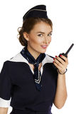 Mooie glimlachende stewardess met cb radio Royalty-vrije Stock Afbeelding