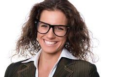 Mooie glimlachende vrouw die glazen draagt Stock Afbeelding