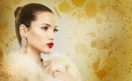 Mooie gouden glamourvrouw Royalty-vrije Stock Fotografie