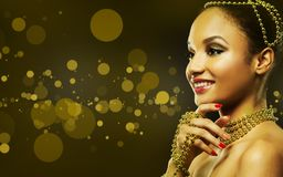 Mooie gouden glamourvrouw Stock Afbeeldingen