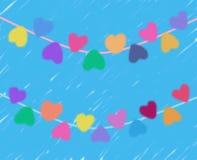 Mooie harten in diverse kleuren tegen blauwe achtergrond royalty-vrije stock afbeelding