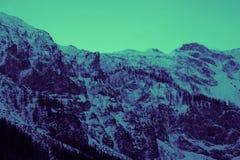 Mooie humeurige ijzige landschaps Europese alpiene bergen Royalty-vrije Stock Afbeeldingen