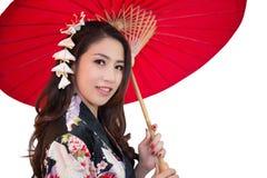 Mooie jonge Aziatische vrouw die traditionele Japanse kimono dragen Royalty-vrije Stock Fotografie
