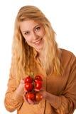 Mooie jonge blonde Kaukasische vrolijke vrouw met blauwe ogen ho Stock Foto