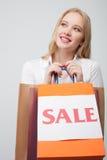 Mooie jonge blonde vrouw met vele pakketten Royalty-vrije Stock Foto's