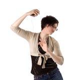 Mooie jonge brunette die met MP3 speler danst stock afbeelding