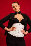 Mooie jonge brunette in een elegante kleding Stock Foto's
