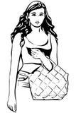 Mooie jonge donkerbruine vrouw met een zak in zijn hand Stock Afbeeldingen
