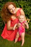 Mooie jonge moeder met baby Royalty-vrije Stock Fotografie