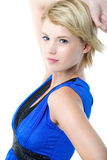 Mooie jonge vrouw in blauwe cocktailkleding. royalty-vrije stock fotografie