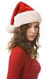 Mooie jonge vrouw in de hoed van de Kerstman Stock Afbeeldingen