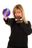 Mooie jonge vrouw die compact disc houdt stock fotografie