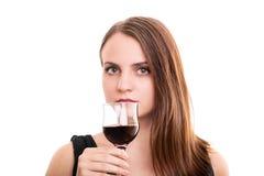 Mooie jonge vrouw die een glas wijn houden royalty-vrije stock fotografie