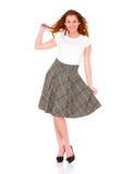 Mooie jonge vrouw die rok op wit draagt royalty-vrije stock afbeelding