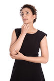 Mooie jonge vrouw in een zwarte geïsoleerde kleding - - nadenkende a stock foto's