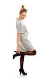 Mooie jonge vrouw in kleding Stock Afbeelding