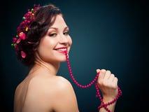 Mooie jonge vrouw met avondsamenstelling Royalty-vrije Stock Foto