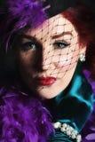 Mooie jonge vrouw met een netto hoed Stock Fotografie