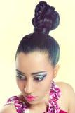 Mooie jonge vrouw met kleurrijke make-up Stock Fotografie