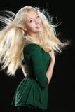 Mooie jonge vrouw met lang blond haar Royalty-vrije Stock Foto