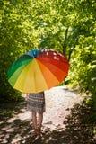 Mooie jonge vrouw met parasol stock foto's