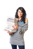 Mooie jonge vrouw met stapel boeken Stock Foto's
