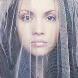 Mooie jonge vrouw onder een sluier Stock Fotografie