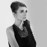 Mooie jonge vrouw in retro stijl Royalty-vrije Stock Foto