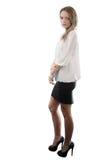 Mooie jonge vrouw status geïsoleerd_ op wit Stock Afbeelding