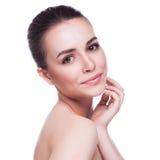 Mooie jonge vrouw wat betreft haar gezicht Royalty-vrije Stock Afbeelding
