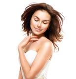 Vrouw wat betreft Haar Huid Stock Foto