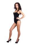 Mooie jonge vrouw in zwarte bikini Stock Afbeeldingen