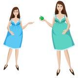 Mooie jonge zwangere vrouw in blauwe kleding Royalty-vrije Stock Afbeeldingen