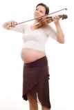 Mooie jonge zwangere vrouw met een viool royalty-vrije stock foto's