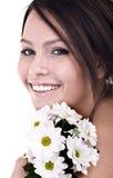 Mooie jongelui met bloem het kijken. Royalty-vrije Stock Afbeelding