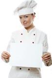Mooie kokvrouw die een berichtraad houdt stock afbeeldingen