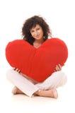 Mooie krullend met groot rood hart Stock Fotografie