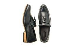 Mooie luxe en de toevallige schoenen van leermensen Stock Afbeeldingen