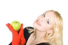 Mooie mannequin die een appel houdt Stock Foto's