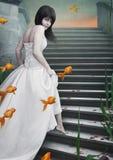 Mooie meisje en goudvis. Royalty-vrije Stock Foto