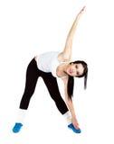 Mooie meisje het uitrekken zich spieren Stock Afbeelding