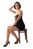 Mooie meisjeszitting op de stoel Royalty-vrije Stock Afbeelding