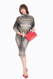 Mooie modieuze vrouw in gestreept kostuum Royalty-vrije Stock Foto's