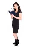 Mooie onderneemster met hoofdtelefoon en notitieboekje Stock Afbeeldingen