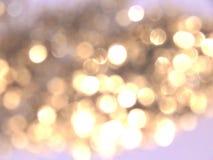 Mooie onscherpe gouden achtergrond, feestelijk bokehlicht Stock Foto's