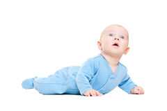 Mooie op vloer ligt en baby die omhoog kijkt Stock Fotografie
