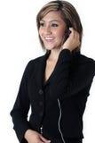 Mooie receptionnist die hoofdtelefoon draagt Royalty-vrije Stock Foto