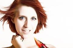 Mooie redhead vrouw in de wind royalty-vrije stock afbeelding