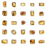 Mooie reeks van 25 grote gouden-bruine kristallen van rietsuikerisol Stock Fotografie