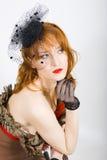 Mooie retro vrouw met uitstekende hoed en sluier Stock Afbeelding